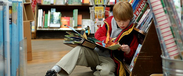 Child reading for pleasure in a book store