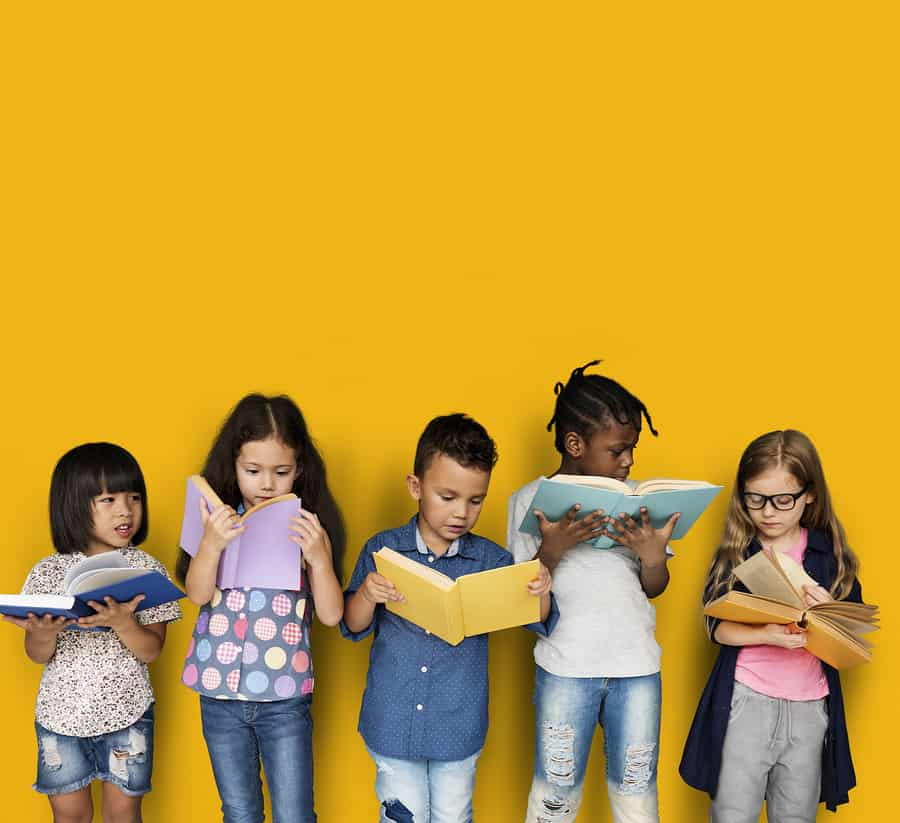 Diverse Group Of Kids Reading Books; importance of inclusion