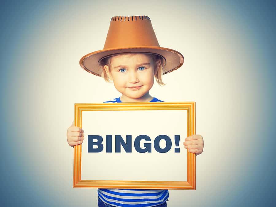 Little girl in striped shirt with blackboard. Text BINGO! (for reading bingo)