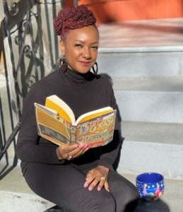 Valarie Pearce reading a book